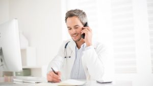 doctor using a healthcare phone system